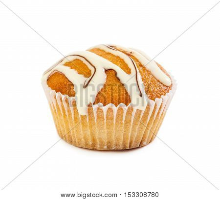Muffin Poured With White Liquid Chocolate Syrup