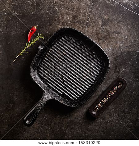 Empty Cast Iron Pan on Black Stone Background