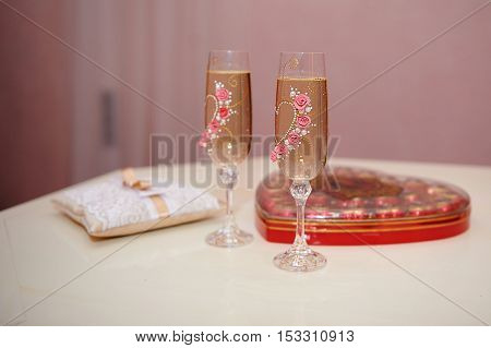 two glasses of champagne on the table for the wedding ceremony.
