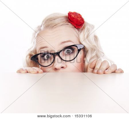 Girl hiding behind a desk