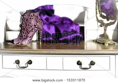 Elegant lace women's boots handmade. Shallow depth of field sharpness on shoes