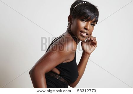 Pretty Black Woman Watching At Camera Wears A Decoration In Hair