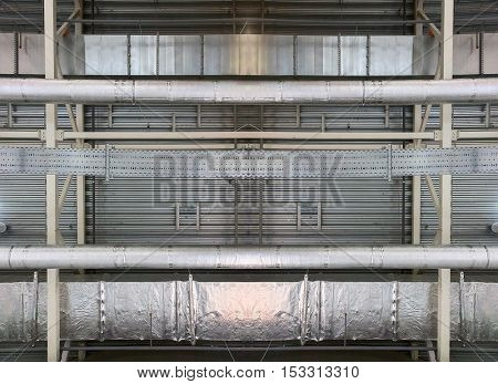 photo of industrial metallic ceiling with pipes