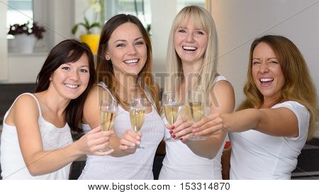 Four Happy Attractive Girlfriends Celebrating