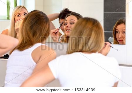 Group Of Young Women Friends Applying Makeup