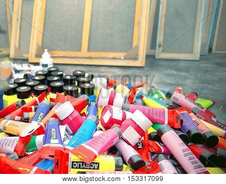 Group of acrylic paints various colors in artist's studio