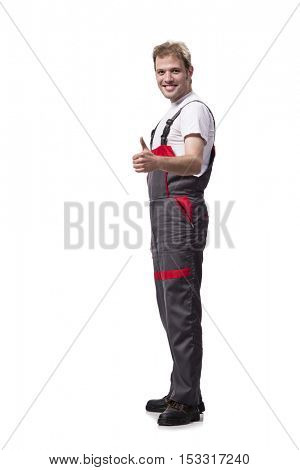 Young construction worker wearing coveralls isolated on white