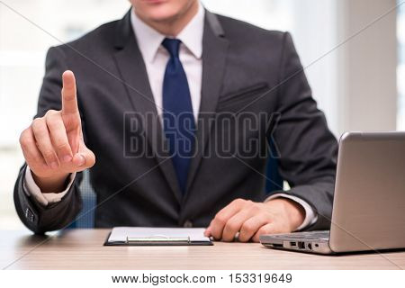 Young businessman pressing buttons in business concept