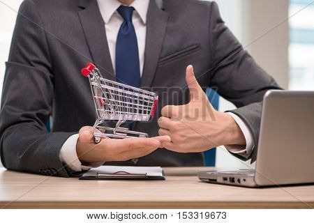 Businesswoman with shopping cart trolley