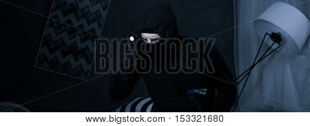 Robber Looking For The Valuable Estate