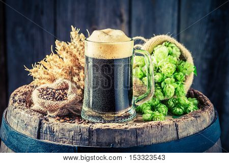 Pint Of Dark Beer With Wheat And Hops