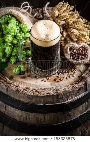 Dark Beer With Foam, Hops And Wheat