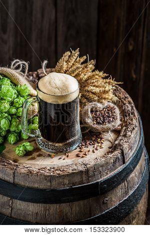 Cold Pint Of Dark Beer With Ingredients, Wheat And Hops