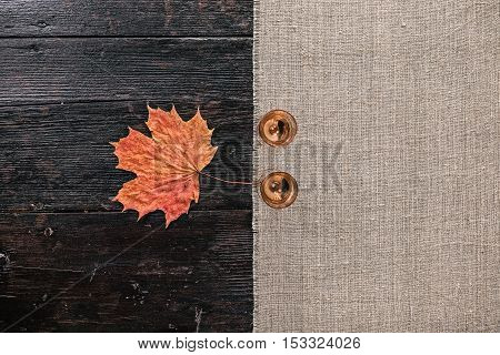 Still life with two empty wineglasses and fallen maple leaf on the half covered table. Flat lay