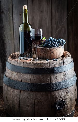 Intensive Glass Full Of Wine And Grapes In Wooden Bowl