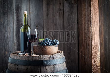 Delicious Glass Full Of Wine With Grapes In Wooden Hut