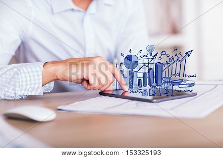 Closeup of businessman hands using digital tablet with creative financial sketch. Business communication concept