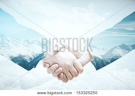 Closeup of handshake on abstract landscape background. Business abroad concept. Double exposure