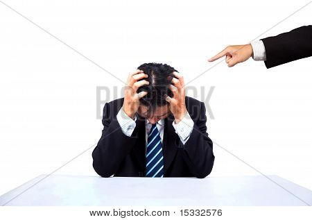 Depressed businessman and Accused's hand with white background.