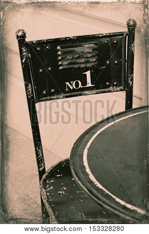 Steel chair in black on a stylized old photo