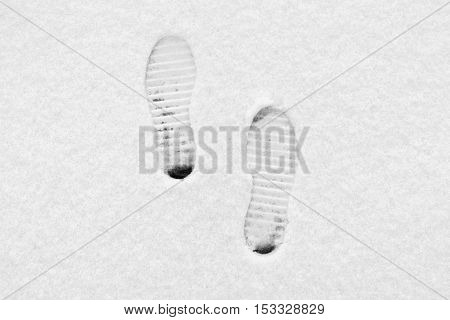 Traces from boots on snow shoe protectors.