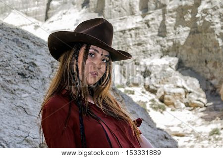 girl in a cowboy hat standing at the white cliffs