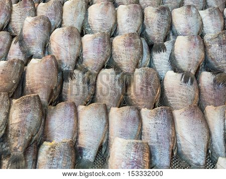 Dried salted gourami fish for sale in market.