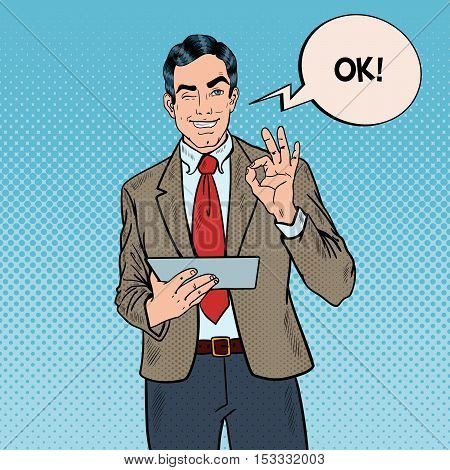 Pop Art Businessman with Tablet Gesturing OK and Winking. Vector illustration