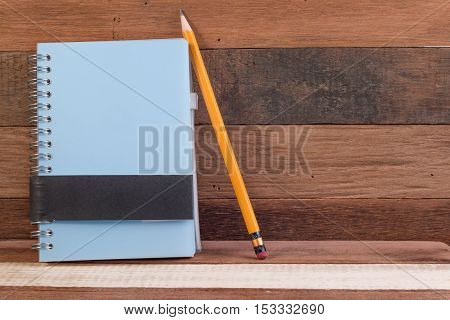Notebook And Pen On Wood Texture Background With Copy Space. Blank Notebook And Pen On Wood Office T