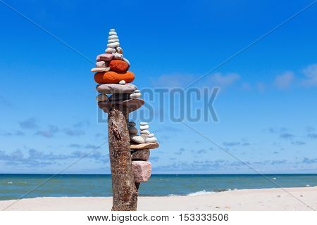 Balance and poise stones. Rock zen on the background of blue sky and sea