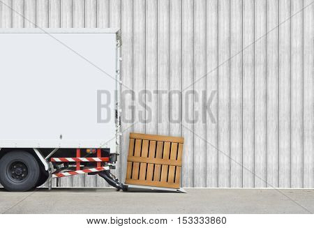 transportation and vehicle concept - Delivery truck parking to delivery parcel wood box with wood wall and copyspace