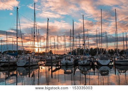 Boats in the harbor from Katwoude in the Netherlands at sunset