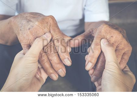 Hands Of Old Man And A Young Human Touching.