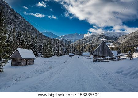 Wooden Cabins Covered With Snow In Winter At Sunset, Tatra Mountains, Poland