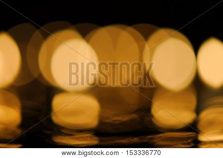 Christmas or romantic concept: warm festive candlelight bokeh