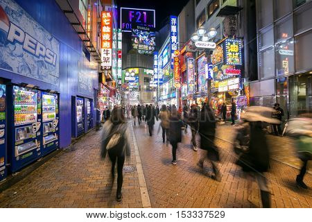 TOKYO - FEB 18: Pedestrians walking at Shibuya on Febuary 18, 2015 in Tokyo, Japan. Shibuya is one of the fashion centers of Japan, particularly for young people, and as a major nightlife area.