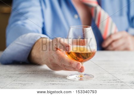 Young Alcoholic Man Drinking Whisky In His Home.