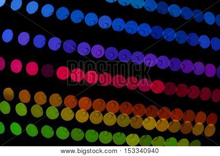 Blurred abstract running LED colored lights. Color Bokeh at Night.