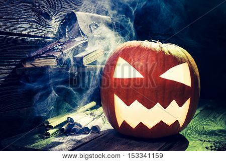 Spooky pumpkin for Halloween on old wooden table