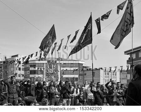 Istanbul Turkey - October 11 2016: Turkish Shia men take part in commemorations marking the mourning period of Ashura. Turkish Shia Muslims mourning for Imam Hussain. Caferis take part in a mourning procession marking the day of Ashura in Istanbul's Kucuk