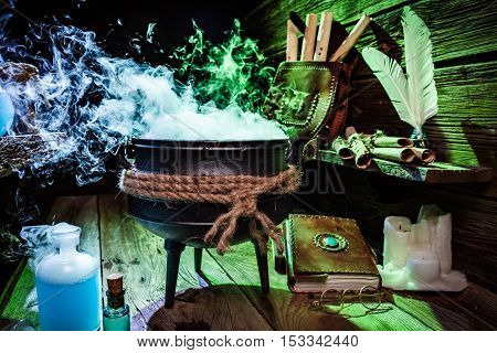 Mysterious Witch Pot With Books And Potions For Halloween