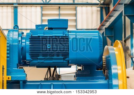 Flange type three phase electric motor installed on the machine