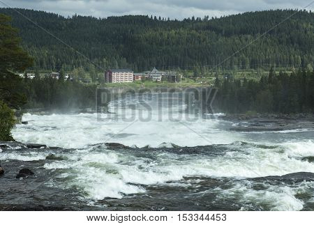STORFORSEN, SWEDEN ON AUGUST 20. View of the rapids and the Hotel on August 20, 2016 in Storforsen, Sweden. Trail on the left-hand side. Forests and hills. Editorial use.