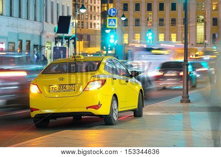 Moscow, Russia - October, 16, 2016: yellow taxi in a center of Moscow
