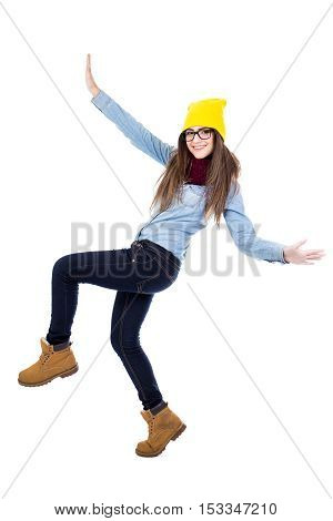 Funny Teenage Girl Dancing In Winter Clothes Isolated On White