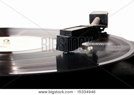 Old vinyl player on white background