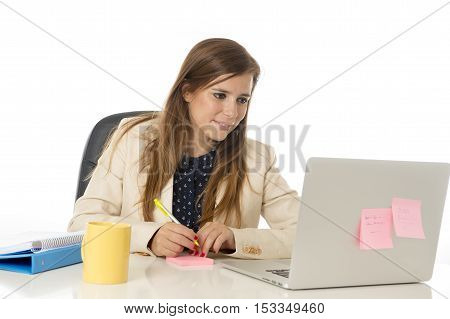 corporate portrait of young attractive businesswoman on her 30s sitting at office chair working at laptop computer desk smiling happy and satisfied isolated on white background
