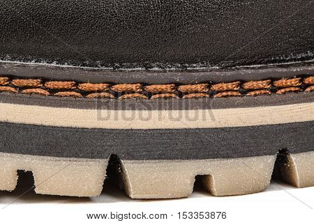 The shoe of needled strong thread stitch of seam close-up isolated on white background