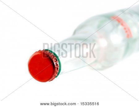 empty bottle with red stopper isolated on white