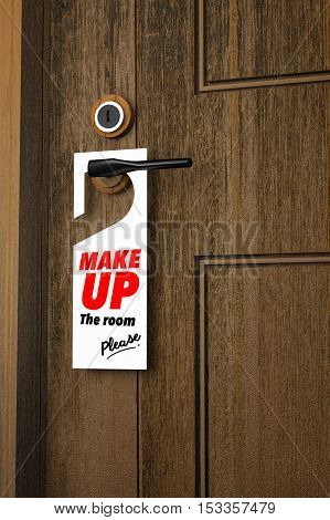 3D : Illustration of white Paper signboard with make up the room please hanging on a handle of wooden door resort or hotel